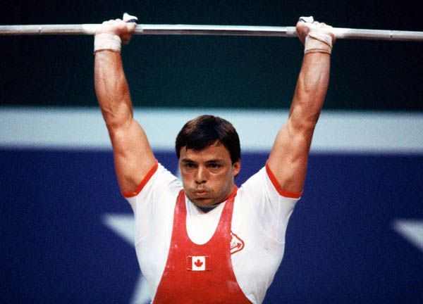Canada's Jacques Demers competes in the weightlifting event at the 1984 Olympic games in Los Angeles. (CP PHOTO/ COA/Tim O'lett )