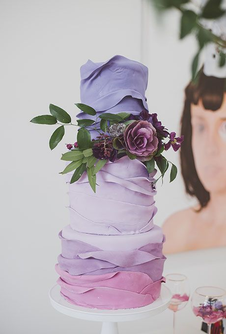 Purple ombré wedding cake with ruffled layer detail