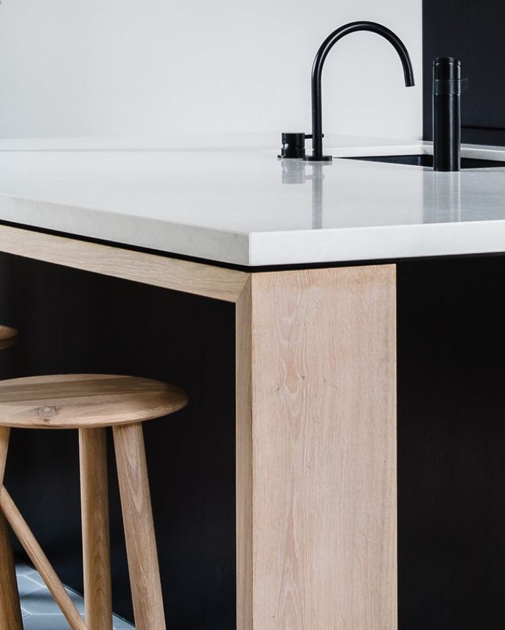 All in the detail Impeccable Kitchen Island in Caesarstone Alpine Mist atop these fantastic timber supports Wait till you see the rest of this exquisite kitchen designed by @georgia_ezra of GABBE & TilesofEzra @ameliastanwix #caesarstone