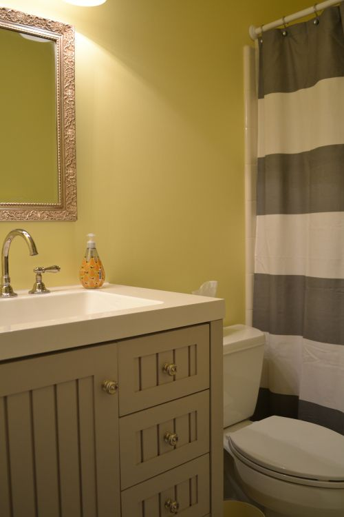Yellow and Gray Bathroom, Sundance by Benjamin Moore, Vanity by Martha Stewart for Home Depot, West Elm striped shower curtain
