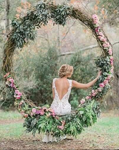 Rustic wedding grapevine large wreath decorated with greenery. Absolutely stunning rustic wedding decor!