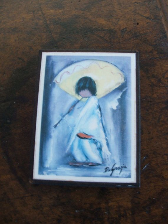 Vintage DeGrazia laminated wall plaque for a small space measures 4.25 x 3.35    Piccolo Pete is as cute as a bugs ear underneath that giant