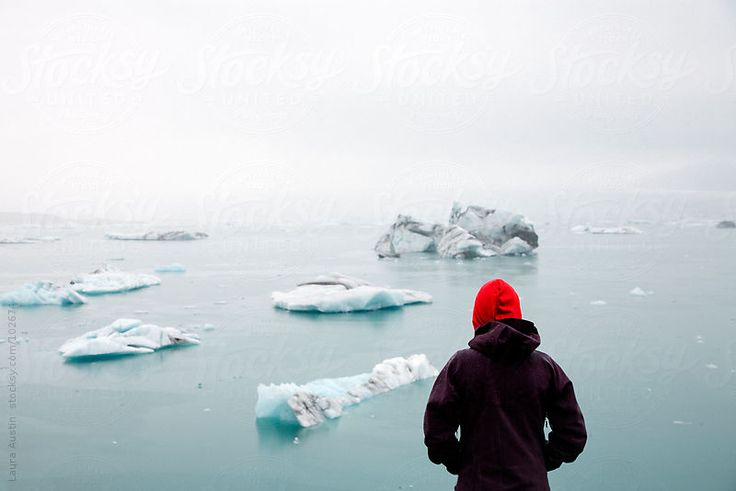 Person Standing In Front Of Glacier Lake In Iceland by Laura Austin