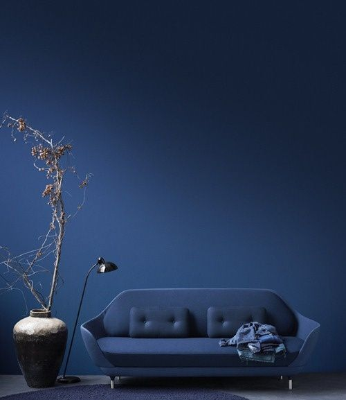Blue sofa on blue background. Sofa by Jame Hayon.