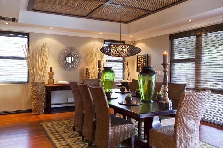 Hanging light, green vase, carpet, wall mirror, unusual ceiling detail
