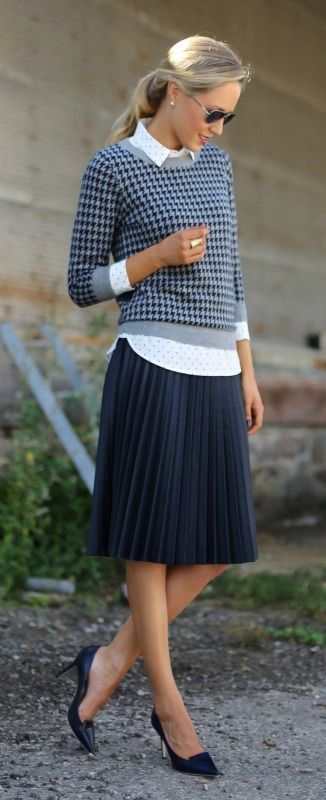 navy and grey houndstooth crewneck sweater, navy and white polka dot shirt, navy pleated skirt