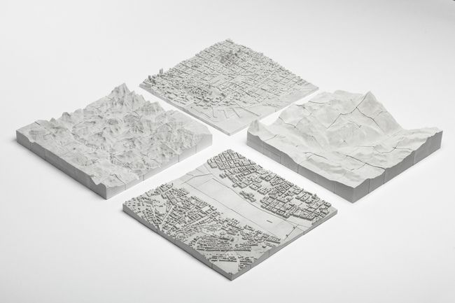 Planbureau's topographical, 3D concrete puzzles of San Francisco, The Grand Canyon, Budapest, and Zermatt.