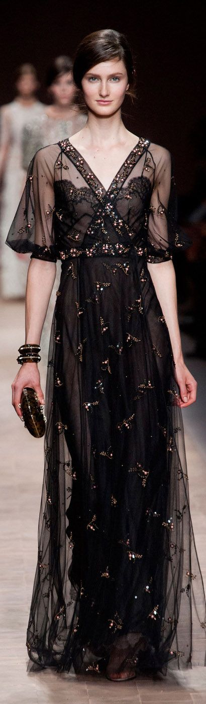 Valentino Spring 2013. A stunning black sheer gown with a gorgeous cross-over neckline, and heavenly embellishments.
