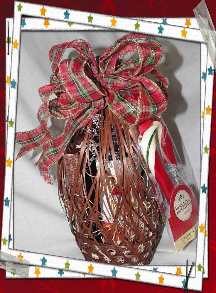 "Wine Gift Basket.       A unique open weave basket decorated for Christmas with a single bottle of wine, toffee treats and candy cane.  A perfect Hostess Gift.  WB001 $39.99     ""Price may vary due to type of wine""   Please note: Can only be picked up by customers of legal drinking age. ID Required."