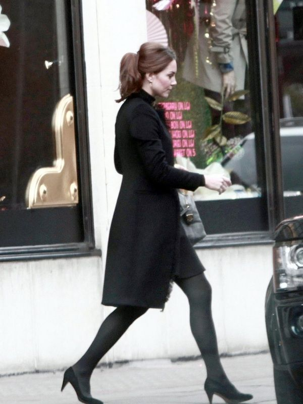 Catherine, Duchess of Cambridge shopping at Harvey Nichols in a black fringe coat, November 10, 2012.