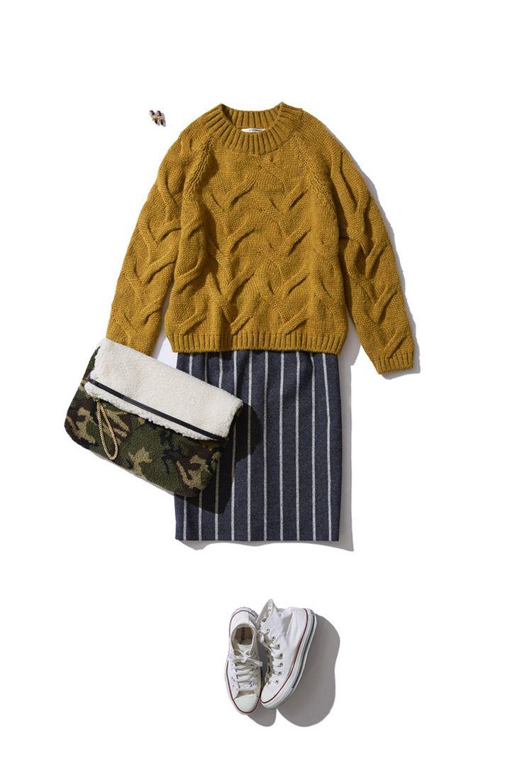 ピンストライプのタイトスカート×カーキのケーブルニットの着こなしは、トレンドがギュッと詰まったちょっぴりモードなシンプルカジュアル。 http://bistroflowers.com/products/detail_1760_181_0.html