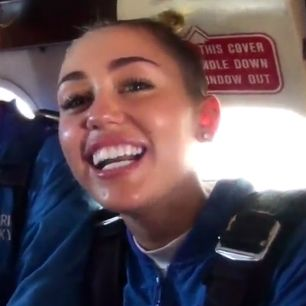 Miley Cyrus Goes Skydiving for Rolling Stone Magazine  Read more at: http://www.heavy.com/entertainment/2013/09/miley-cyrus-skydiving-video-jumps-plane-rolling-stone/