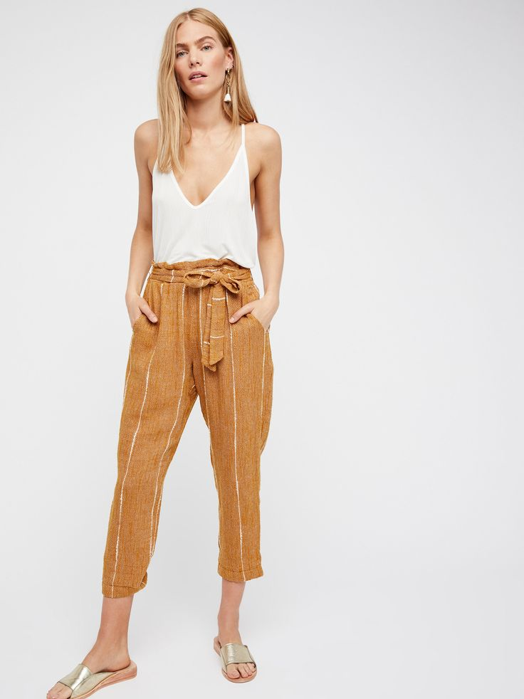 Wild Coast Trouser | High rise trousers featuring a super relaxed feel with an effortless tie at the waist.    * Elastic band at the waist   * Side pockets
