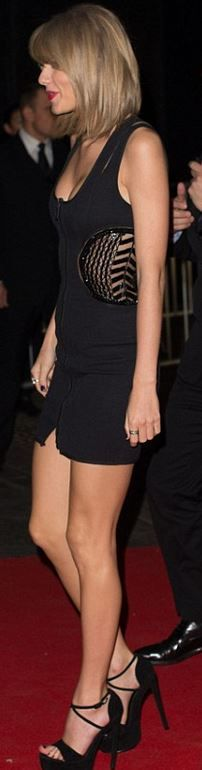 Who made Taylor Swift's black cut out dress and platform sandals?