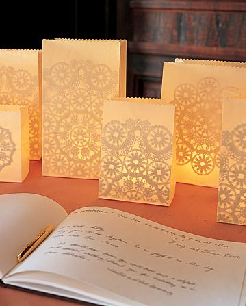 Use simple paper bags, glue some pretty lace or doilies on the inside and put a light inside - it's super easy and so pretty!