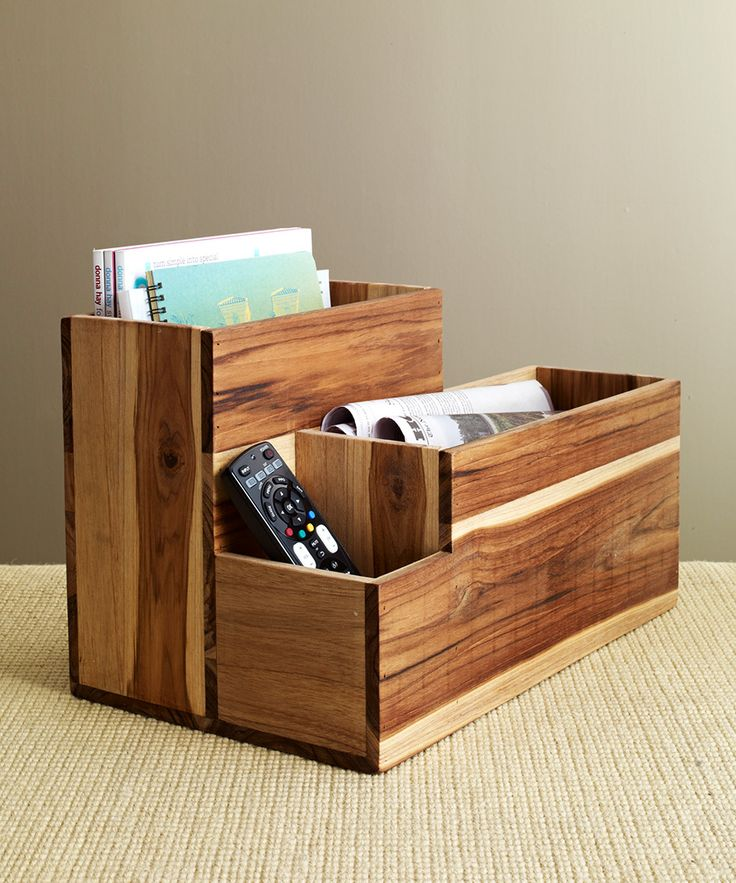 This artsy teak magazine holder has not one but two large sections designed for magazines, newspapers, iPads, and anything else you might need!  Find the Multi-Use Magazine Caddy, as seen in the Storage Clearance Collection at http://dotandbo.com/collections/end-of-summer-sale-storage-clearance?utm_source=pinterest&utm_medium=organic&db_sku=DIM0015-mag