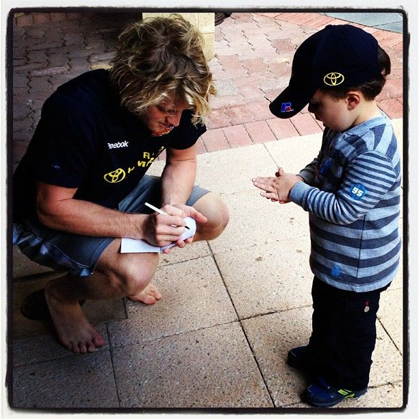 Rory Sloane with a young fan by @adelaide_fc