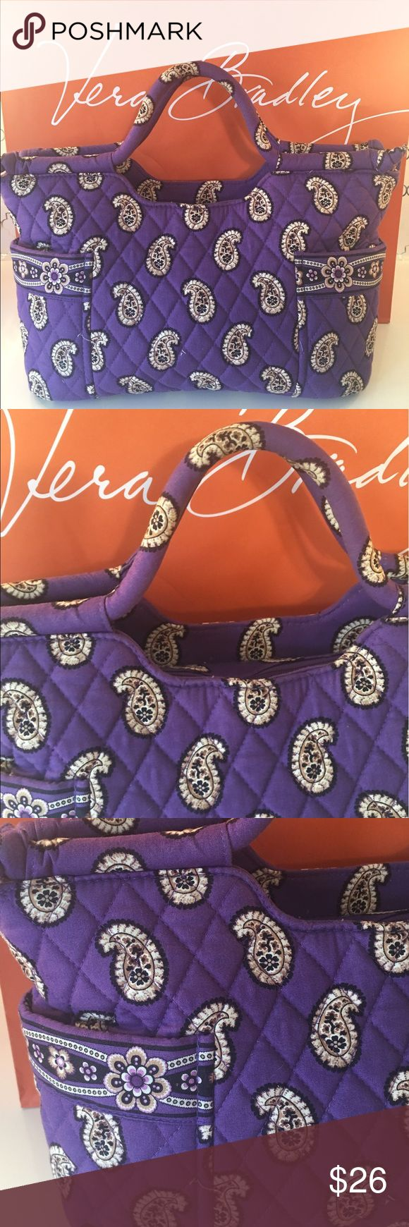 ⭐️VERA BRADLEY ROOMY BAG 💯AUTHENTIC. VERA BRADLEY LOVELY ROOMY BAG 100% AUTHENTIC. WHAT A LOVELY BAG IN PURPLE! STUNNING AND STYLISH PERFECT FOR ANY OCCASION! THIS BAG HAS TWO GREAT OUTSIDE POCKETS! RHE ROOMY MAIN COMPARTMENT HAS FOUR GREAT WALL POCKETS. THE BAG ALSO HAS A ZIP TOP CLOSURE TO KEEP YOUR ITEMS SAFE. SO PRETTY. THE BAG MEASURES 14 INCHES WIDE BY 9 INCHES TALL! Vera Bradley Bags