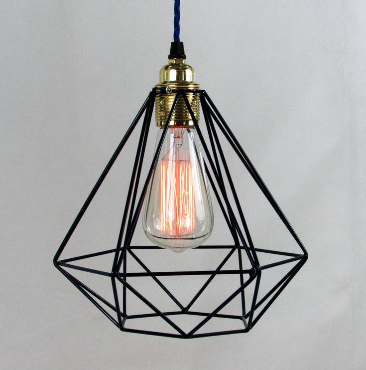 Modern diamond shaped cage pendant with decorative filament light bulb and coloured fabric cable in two styles.The cable is available in a selection of colours and in two cable styles. Ceiling rose is available in black, white, brass, chrome or copper. Choose your required cable length above. If you would like a specific length please get in touch via the 'order enquiry' button after order.This eye catching cage pendant can can easily blend into any modern environment. I have tried to bring…