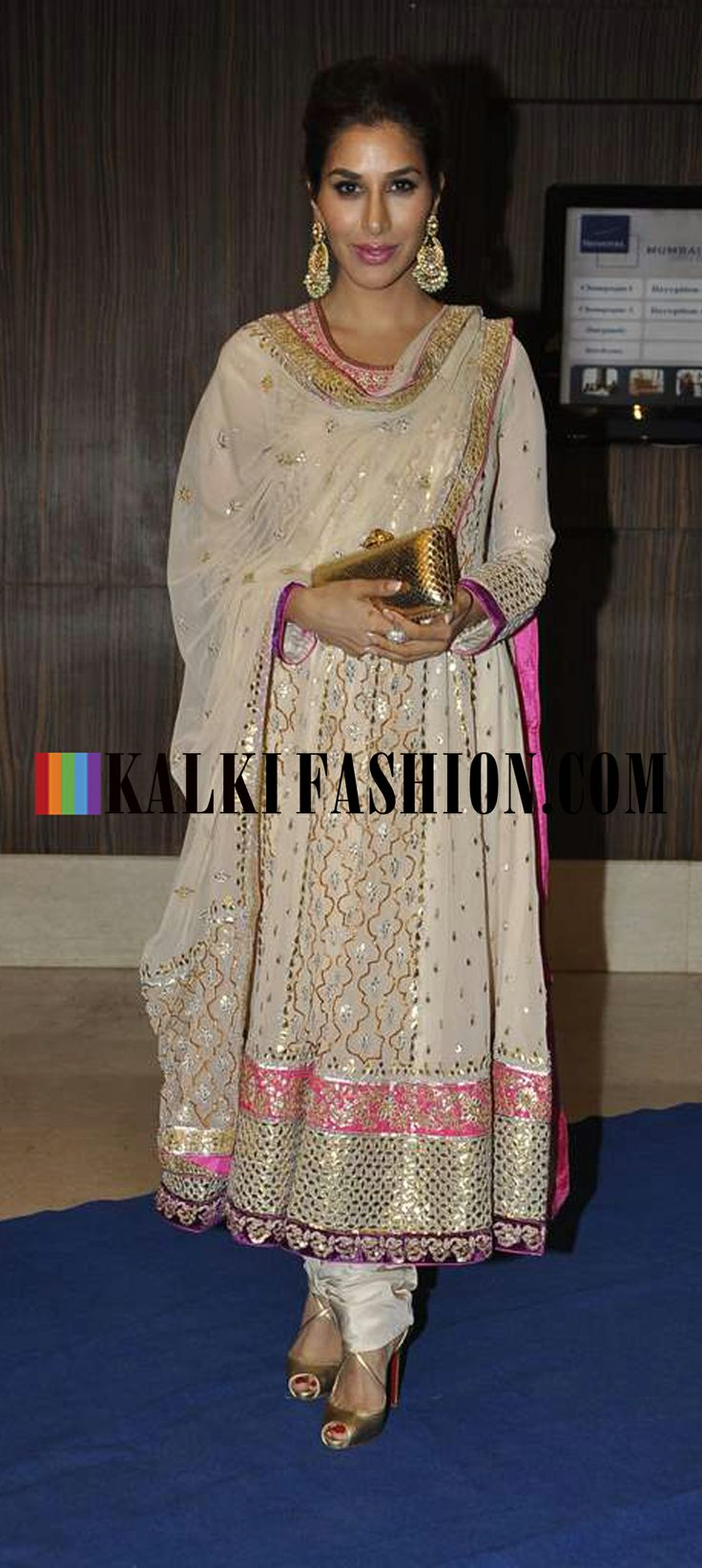 http://www.kalkifashion.com/ Sophia Chaudhary in off white anarkali suit attends Toshi Rana's Wedding