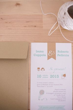 aqua and kraft wedding invitation http://weddingwonderland.it/2016/02/un-abito-jenny-packham-un-matrimonio-la-pioggia.html