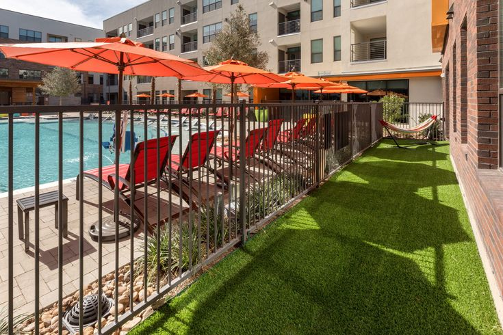 Find your own slice of shade beside the resort-style swimming pool at AMLI on Aldrich, a luxury Austin apartment community.