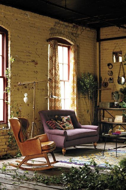 Counterbalance Floor Lamp - anthropologie.com -- I like the rocking chair and settee and use of mirrors, too...