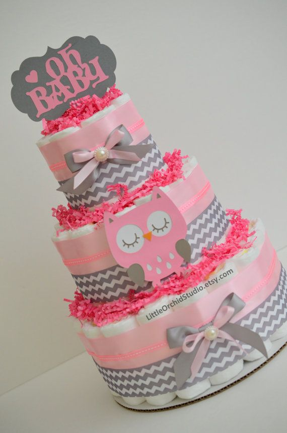 Lovely owl diaper cake in colors of pink and grey will give a perfect touch to the baby shower decoration or as a token of love for mommy to be!!  ** Size 1 pampers swaddlers diapers ** 100% usable diapers once disassembled ** 4 layer owl die cut ** Premium ribbon ** Cakes comes fully assembled * Mini cakes - 7 count size 1 diapers, measure approx 9 tall and 5 wide * 2 Tier - 28 count size 1 diapers , measure approx 12 tall and 9  wide * 3 Tier - 60 count size 1 diapers, measures approx 15…