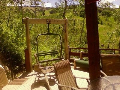 The Swinging Chair Lift Seat on the Deck Overlooking the Ski Slope