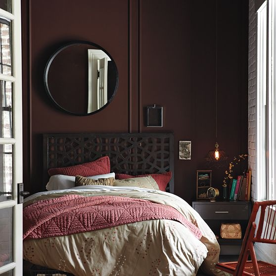 West Elm Bedroom With Large Round Mirror And Pendant Lamp Above Nighstand
