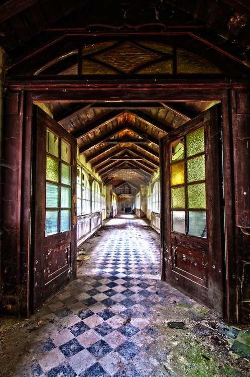 I just love the flooring for a wedding venue.   corridor with checkered floor