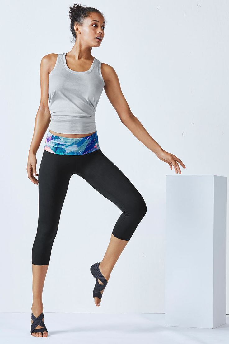 Say hello to a new way to yoga with our feel-good, tissue tank and even comfier and easy-to-flow-in foldover performance capris.