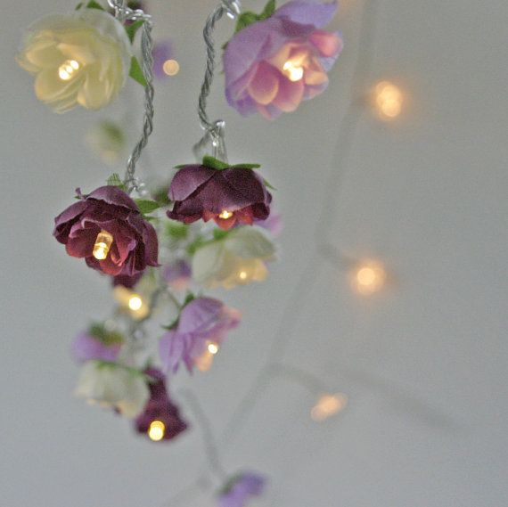 Rose Fairy Lights in Magenta Lilac and Apple White Rambling Rose String Garland Flower Lights A decorative string of mixed rambling roses in magenta purple , lilac and apple white with warm white LED lights. The fairy lights are powered by battery which means they are very versatile - use to decorate a table (birthday, baby shower, dinner parties or your craft fair table!) or around your home The roses measure approx. 4 cm across ( just over an inch) length of string of 20 roses is approx…