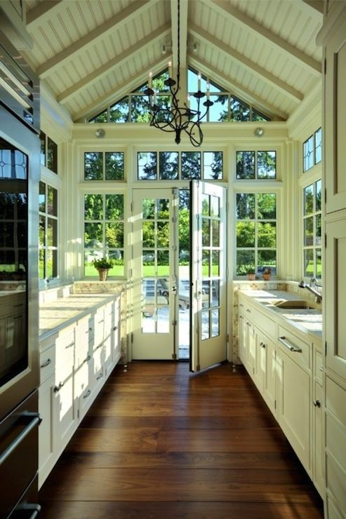 Love the wide plank flooring, white cabs, architectural roof, and amazing wall of windows.