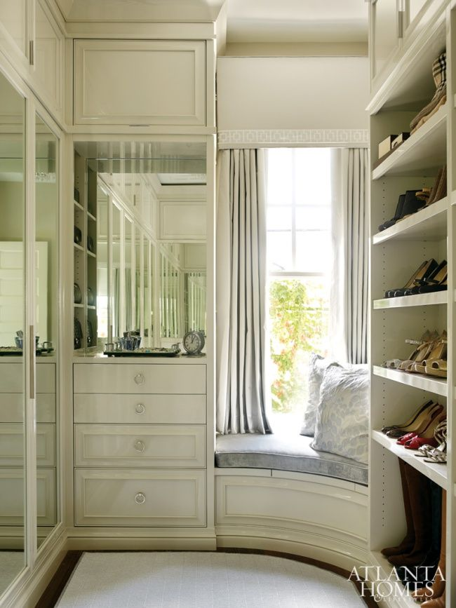 Closet Organization: Part One - Design Chic - window seat perfection - love how the put it in the curve and great mirrored doors