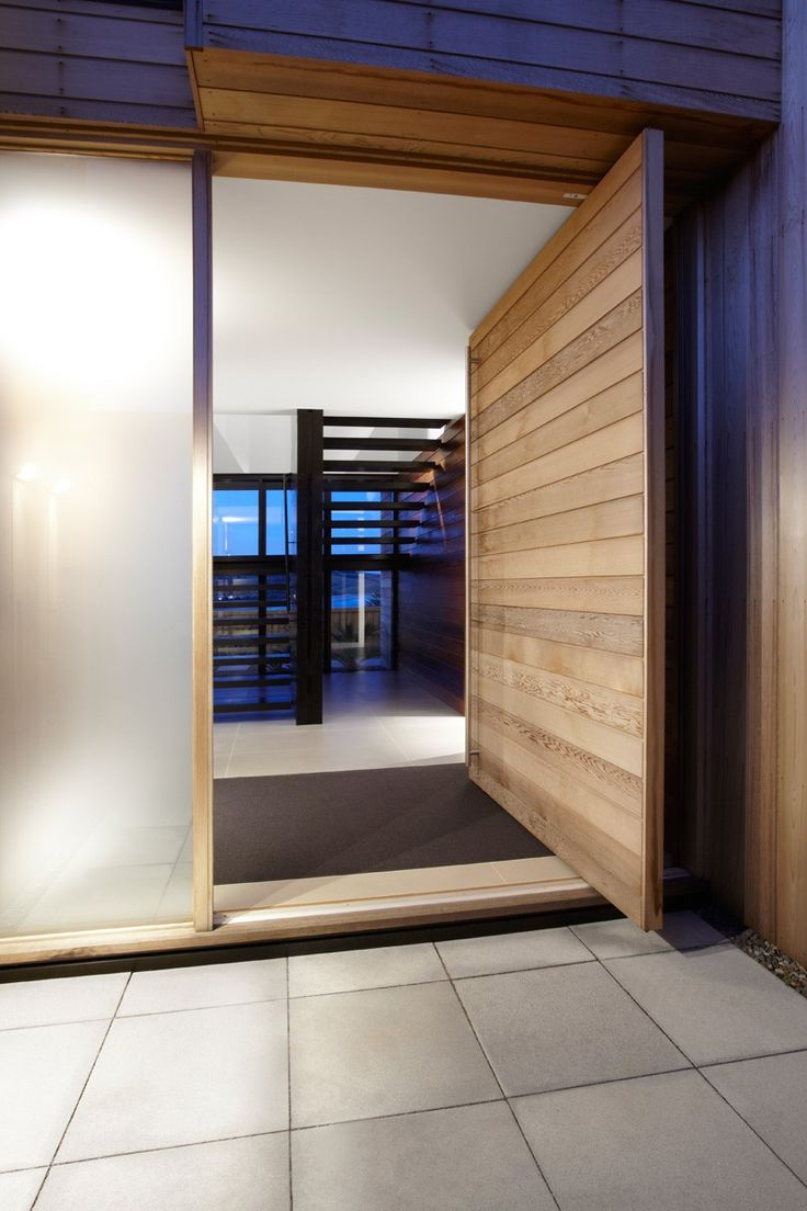 60 best design doors windors images on pinterest architecture minimalist house oversized wood door at entry way at this timber clad home that