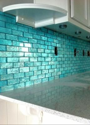 I am so in love with this aqua blue tile. It would totally match the colors for my kitchen!