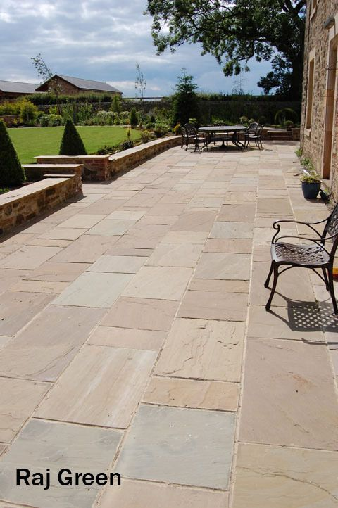 Raj Green Patio Paving Slabs. Natural Indian Sandstone in Mixed Sizes | eBay. I imagine the back patio to look like this with small wall enclosing the space and steps down into the garden