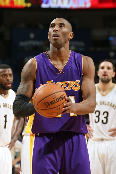 Kobe Bryant attempts a foul shot: Bryant suffered a right shoulder rotator cuff tear in the third (4:14 left in the quarter) after converting on a two-handed dunk.  He could be out for the year with this latest injury. (January 21, 2015 | Los Angeles Lakers @ New Orleans Pelicans | The Smoothie King Center in New Orleans, Louisiana)