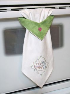 cute kitchen towel - wouldn't have to do your own embroidery. Just a plain towel would be handy hanging like this