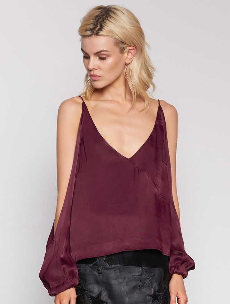 ISLA ETHEREAL TOP. Like sippin on fine french wine this low-V, off the shoulder long sleeve top is made from smooth burgundy satin and just slips easily over the body. With a front diagonal seam, and loose blouson tie cuffs. Available www.islalabel.com