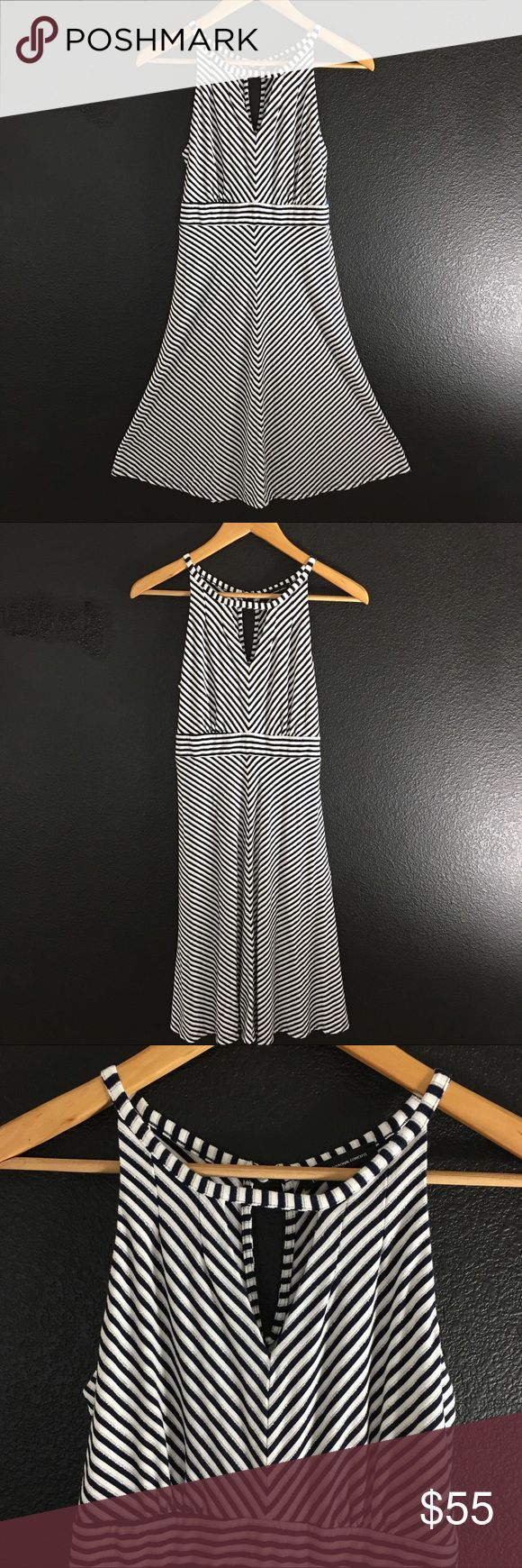 "Classic Keyhole Halter Midi Striped INC Dress S Feel your best, Elegant and Smart in this Classic Keyhole Halter Stripe Dress by INC. This Soft Dress is  perfect for Weddings, Sailing, Vacation, Summer Dates, and a plain o'l Summer day where you want to get a little dressy. White, Navy, & Silver Metallic Stripes Size Small  90% Rayon 5% Spandex 5% Other (Stated on the Tag) Made in Republic of Korea Bust: 30"" Waist: 24"" Hip: 31"" Shoulder to Hem: 37""  Thank you for shopping! INC International…"