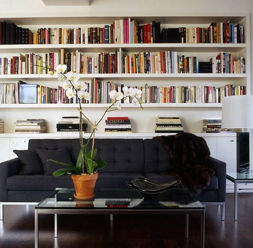 Glenn Gissler:Almost like an abstract work of art, book-lined shelves add a dash of color to themostly black, brown, and whitepalette of this Greenwich Village penthouse apartment I designed for fashion maestroMichael Kors. The sofa and coffee table are modern classics by Florence Knoll