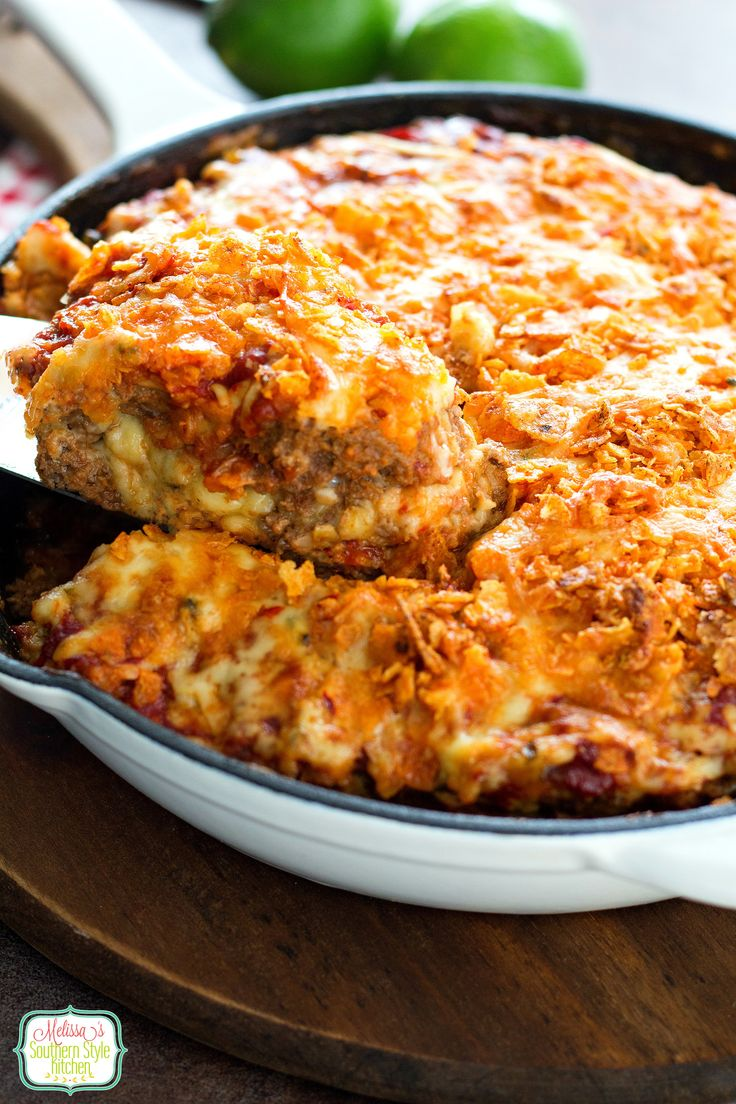 This cheese stuffed taco meatloaf takes a dish that's often thought of as a humdrum over-the-top. Being a lifelong fan of meatloaf this spiced-up taco variation is one more way for my meatloaf lovin' family to enjoy it. Seasoned lean ground beef is stuffed with spicy pepper-jack cheese then mixed together with our favorite fiesta seasonings and crushed Doritos, turning this taco meatloaf into homemade fiesta any say if the week.