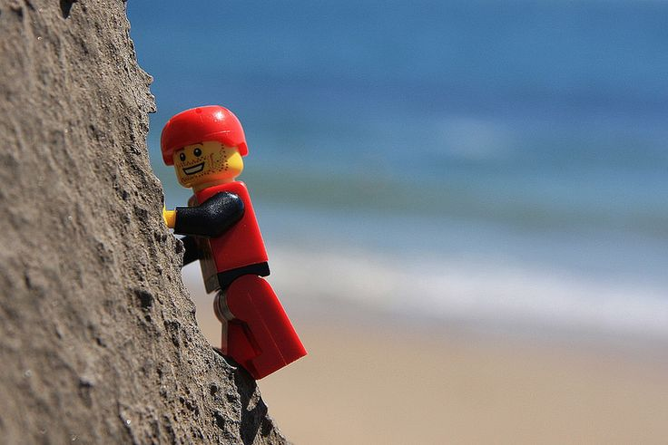 Sun, Sea and Limestone: A sunny weekend means sea cliff climbing. Lego Dan is delighted.