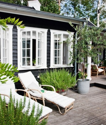 black weatherboards and white windows