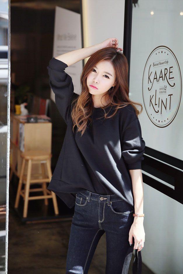 Black quarter length sleeve shirt and skinny jeans