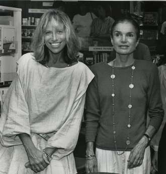 Jackie and Carly Simon collaborated on four books for children during the 1980s.  Here they pose for a photograph by Carly Simon's brother Peter at a launch party in a bookshop on Martha's Vineyard.