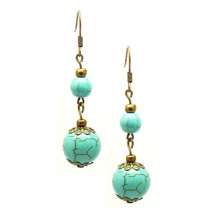 This handcrafted pair of dangle earrings from Pretty Little Style features Turquoise beads and antique bronze bead caps. The combination of bronze and turquoise creates a sophisticated and classic loo