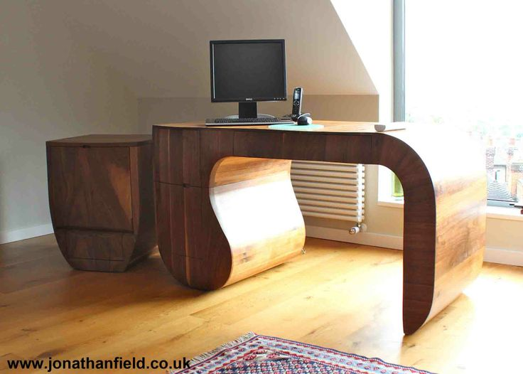 Opener desk in solid American black walnut, oiled finish, ply sub structure. The desk has three drawers. One of an edition of five. Designed to go with the Opener Chair and Opener Printer Unit 140cm x 72cm x 76cm H Jonathan's work is shown by Connaught Brown www.jonathanfield.co.uk